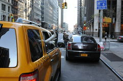 Yellow taxi cab cars. New York Yellow taxi cab cars with doll legs coming out from the window Royalty Free Stock Photo
