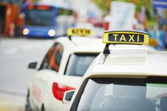 Yellow taxi cab cars. Waiting  for a client passenger in turn Royalty Free Stock Photo