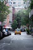 Yellow Taxi Cab on City Streets Royalty Free Stock Photo