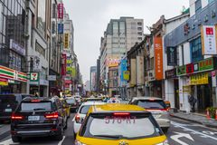 Taiwanese taxi in a traffic jam. A yellow taxi cab in downtown Taipei, Taiwan, standing in a traffic jam Royalty Free Stock Photos