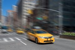 Yellow taxi motion blur in New York City Royalty Free Stock Image