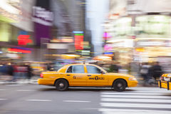 Yellow Taxi Cab in motion,. Times Square, New York City, New York, USA Stock Photography