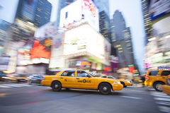 Yellow Taxi Cab in motion,. Times Square, New York City, New York, USA Royalty Free Stock Photos