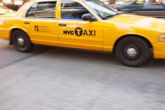Yellow Taxi Cab in motion,. Times Square, New York City, New York, USA Royalty Free Stock Images