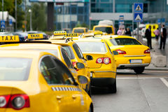 Yellow taxi cabs. Waiting in front of airport terminal stock photo