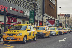 Yellow taxi cabs, Bucharest, Romania Royalty Free Stock Images