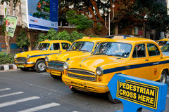 Yellow taxi cabs stopped at a pedestrian crossing Stock Images