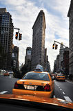 Yellow taxi cabs under the Flatiron Building Stock Photography