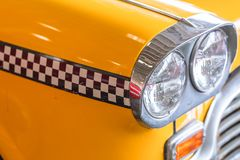Yellow taxi car close up head light for taxi driver royalty free stock photography