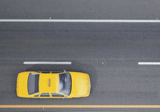 Yellow taxi car on the road, background Royalty Free Stock Images
