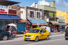Yellow taxi car on the road of Izmir city Royalty Free Stock Image
