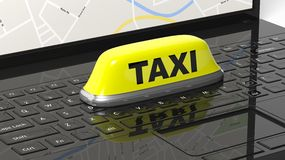 Yellow taxi car roof sign on black laptop Royalty Free Stock Image