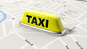 Yellow taxi car roof sign on map Stock Photography