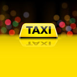 Yellow taxi car roof sign at night Stock Photos
