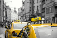 Yellow Taxi cars on the street Stock Images