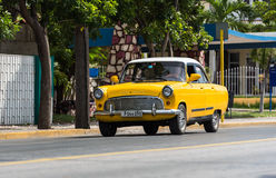 Yellow taxi classic car under way in Cuba Stock Photography