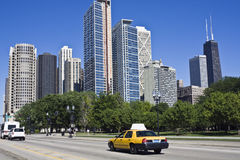 Yellow taxi in downtown Chicago Stock Image
