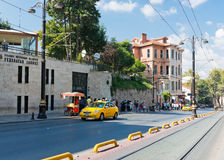 Yellow taxi driving in downtown of Istanbul on August 24, 2013 Royalty Free Stock Photo