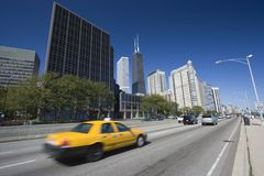 Yellow Taxi driving Lake Shore Drive Stock Image