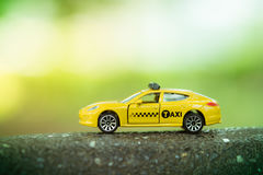 Yellow taxi. On green nature background Royalty Free Stock Photo