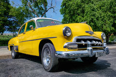 Yellow taxi in Havana Royalty Free Stock Photo