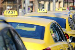 Yellow taxi in line on the street Royalty Free Stock Photography