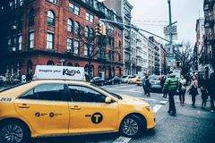 Yellow Taxi in Middle of Street Road Royalty Free Stock Photography