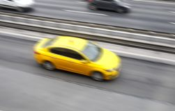 Yellow Taxi Motion Blur Royalty Free Stock Photos