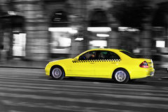 Yellow taxi. Moves on the night city street Royalty Free Stock Photography