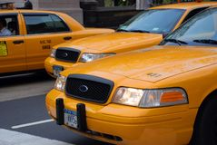 Yellow taxi in new york city. USA, busy streetscene royalty free stock photography