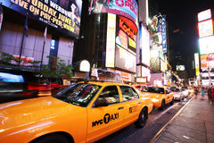Yellow taxi in New York Times Square. NEW YORK - JUNE 7: Yellow taxi in New York Times Square traffic at night on June 7, 2008 Royalty Free Stock Photos