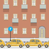 Yellow Taxi Parked Beside Pedestrian. Stock Photo