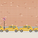 Yellow Taxi Parked Beside Pedestrian. Royalty Free Stock Photo