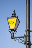 Yellow Taxi Sign Stock Images