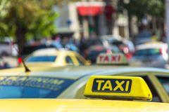 Yellow taxi sign on cab vehicle roof stock image