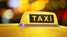 Yellow taxi sign on car stock video footage