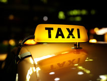 Yellow taxi sign at night Royalty Free Stock Image