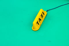 Yellow taxi sign on turquoise old car Stock Photo
