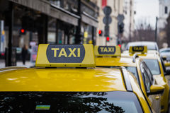 Yellow Taxi Signs in Budapest Stock Photography