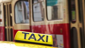 Yellow taxi symbol closeup. Yellow taxi symbol in the background of a passing vehicle stock video footage