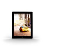 Yellow taxi on tablet screen Royalty Free Stock Image