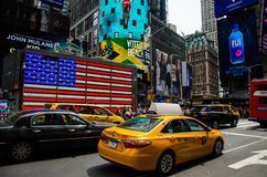 Yellow Taxi in Time Square, New York stock photo