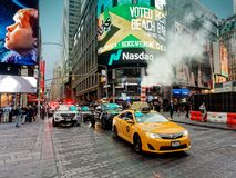 Yellow taxi in Times Square Manhattan New York City USA. New York City, USA - April 2018: Yellow taxi in Times Square Royalty Free Stock Photography
