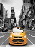 Yellow taxi in Times Square Manhattan New York City USA. New York City, USA - April 2018: Yellow taxi selective colour in Times Square Royalty Free Stock Image