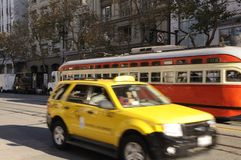 Yellow taxi and tram train Royalty Free Stock Images