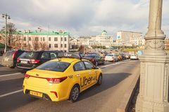 Free Yellow Taxi UBER Rides On The Streets Of Moscow In The Flow Of Cars Royalty Free Stock Images - 166857059