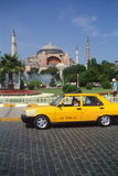 Yellow taxi waits outside Hagai Sofia. Istanbul, T Stock Photos