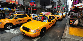 Yellow Taxicab before Times Square Stock Photography