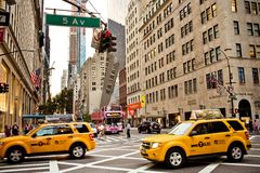 Yellow taxis rides on 5th Avenue in New York Royalty Free Stock Photography