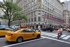 Yellow taxi on street in Manhattan Stock Images